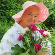 A woman with a bouquet of peonies — Stock Photo