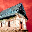 The Old temple isolated on red sky background - Stock Photo