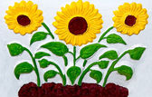 The Ceramic of sunflower on wall background — Stock Photo