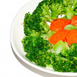 The Stir fried brocolli and carrot isolated on white background — Stock Photo