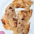 The Fried roti on dish - Stock Photo