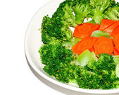 The Stir fried brocolli and carrot isolated on white background — Stockfoto