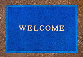 The Doormat of welcome text on floor background — Stock Photo