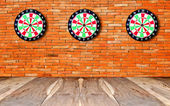 The Perspective view of old wood floor with dartboard — Stock Photo