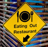 The Yellow plate post of eating out restaurant — Stok fotoğraf