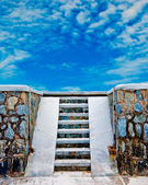 The Stairs down to the beach on blue sky background — Stock Photo
