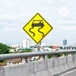 The Yellow slippery road sign on expressway — Stock Photo