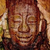 The Sculpture sandstone head of deva — Stock Photo
