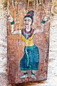 The Old painting on wood isolated on wood background — Stock Photo