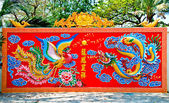 The Colorful of dragon and phoenix on wall of joss house — Stock Photo