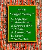 The Green blackboard of menu coffee on brick wall background — Stock Photo