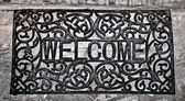 The Doormat curved steel of welcome text on floor background — Stockfoto