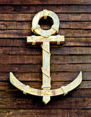 The Old wooden anchor on wood wall background — Stock Photo