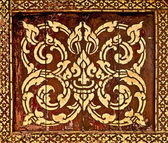 The Traditional Thai style art golden painting pattern on wood i — Stock Photo