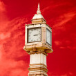 图库照片: Thai tower clock of number thai style isolated on red sky ba