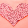 Stock Photo: Heart shape paper decoration on wall