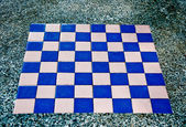 The Chess board on rock table — Stock Photo