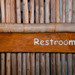 The Sign of restroom on wood background - Stock Photo