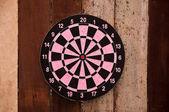 The Dartboard on wood background — Stock Photo