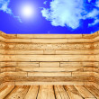Stock Photo: 3D view of room made of wood on blue sky with sunshine backg