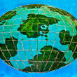 Stock Photo: Ceramic of whole world on blue background