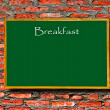 Stock Photo: Green menu blackboard with empty space on brick wall background