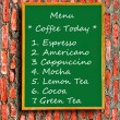 The Green blackboard of menu coffee on brick wall background — Stock Photo