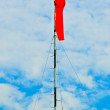 Stock Photo: Wind sock with point of compass