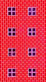 Der Glasstein auf rote Wand — Stockfoto