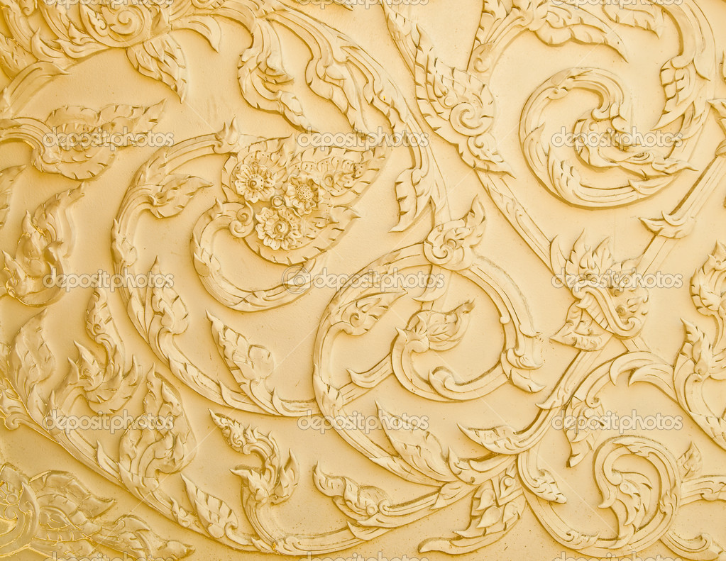 Thai Design Wallpaper : The stucco design of native thai style on wall stock