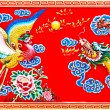 Colorful of dragon and phoenix on wall of joss house — Stock Photo #11737543