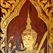 The Traditional Thai style painting art of door in the temple - 图库照片