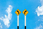 The Direction sign turn left and turn right isolated on blue ba — Stock Photo