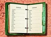 De vintage notebook geïsoleerd op roze marmeren achtergrond — Stockfoto