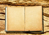 The Vintage blank book isolated on wooden background — Stock Photo