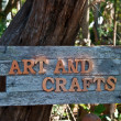 The Word of art and crafts on old wood - Stock Photo