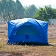 Stock Photo: The Blue tent on the forest