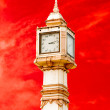 Foto Stock: Thai tower clock of number thai style isolated on red sky ba