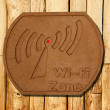 The Sign of wi-fi zone on wood background — Stock Photo