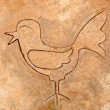 Royalty-Free Stock Photo: The Iron pattern line of bird on cement floor