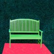 Stock Photo: Green bench with red heart background