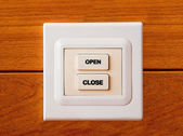 The Switch button of open and close on wood background — Stock Photo