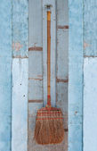 The Old broom on wood background — Stock Photo