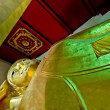 Reclining buddha status - Stock Photo