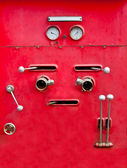 The Chrome dials and valves on old red fire truck — Stock Photo