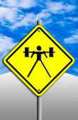 Weight-lifting icon in traffic plate. — Stock Photo
