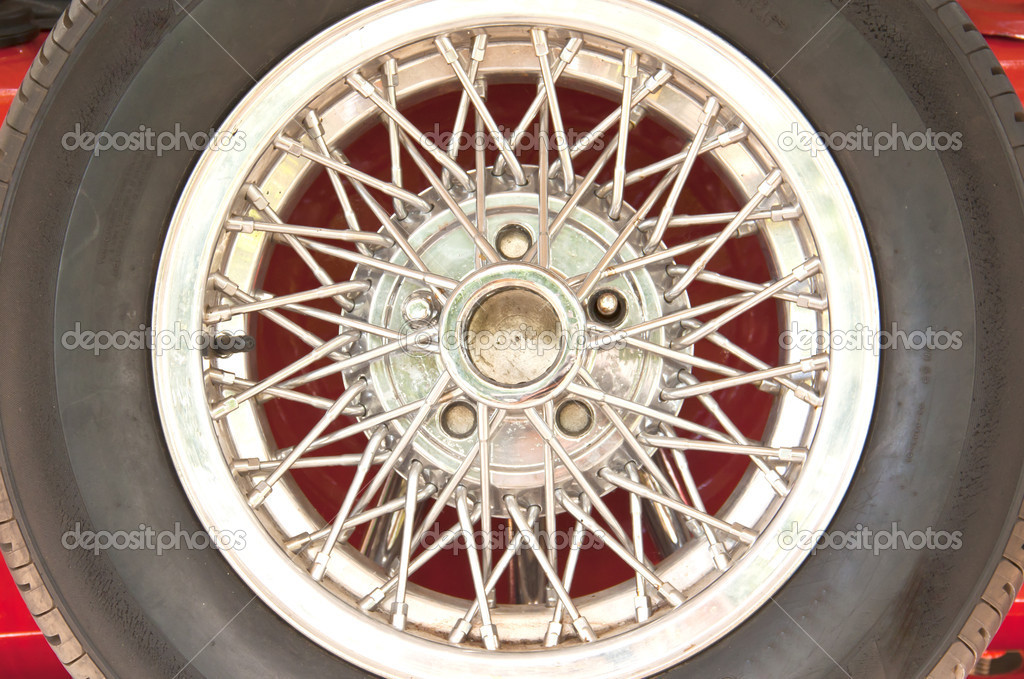 Car wheel and the ring is decorated with a beautiful wire. — Stock Photo #11789035