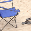 Folding chair and slippers. — Stock Photo