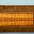 Stockfoto: Reflection of wood house in water