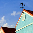 Stock Photo: Cupid on weathervane